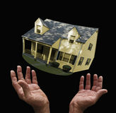 Hands tossing house Stock Photography