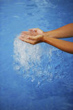 Hands touch water Stock Photos