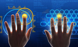 Hands touching blue holographic screen Royalty Free Stock Image