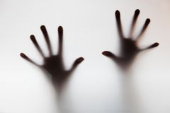 Hands touching frosted glass. Conceptual scream fo Stock Photos