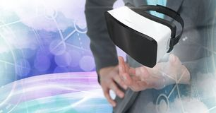 Hands touching and interacting with virtual reality headset with transition effect Royalty Free Stock Image