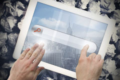 Hands touching search bar on tablet screen Royalty Free Stock Image