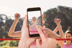 Composite image of hands touching smart phone Royalty Free Stock Photos
