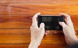 Hands touching smartphone. Stock Photography