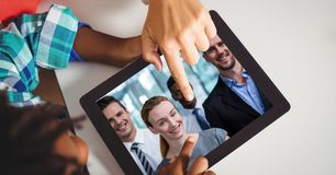 Hands touching tablet PC while video conferencing Royalty Free Stock Photos