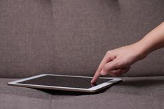 Hands touching tablet screen royalty free stock photo