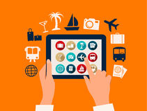 Hands touching a tablet with vacation and travel icons. stock illustration