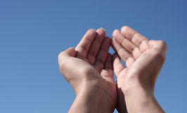 Hands toward the sky. Hands cupped and raised towards the sky Stock Image