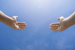 Hands towards sky Stock Photography