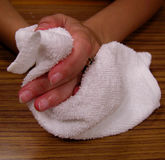 Hands and towel. A very common attitude in any Japanese restaurant Royalty Free Stock Photo