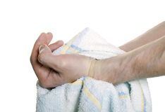 Hands with a towel Royalty Free Stock Photos