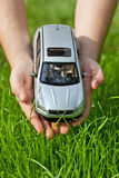 Hands with toy car Stock Images