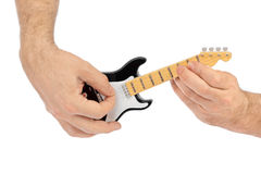 Hands and toy electric guitar Royalty Free Stock Images