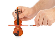Hands and toy violin Stock Photos