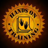 Hands On Training Symbol in Gold On Black Royalty Free Stock Photo