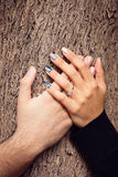 Hands on Tree Bark. Couple's Hands on Tree Bark Stock Images