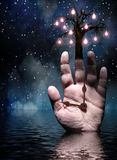 Hands of Tree of Light Stock Photo