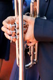 Hands on a trumpet close up. Royalty Free Stock Images