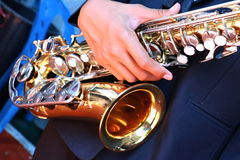 Hands on a trumpet close up. Royalty Free Stock Image