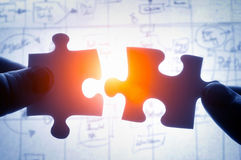 Free Hands Trying To Fit Two Puzzle Pieces Together Royalty Free Stock Photography - 64004277