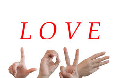 Hands trying to send symbols like alphabet the word love. Stock Image