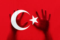 Hands on Turkey flag. Human hands on textured Turkey flag royalty free stock photography