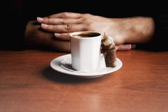 Hands with Turkish Coffee. With a nice cooki Royalty Free Stock Photography