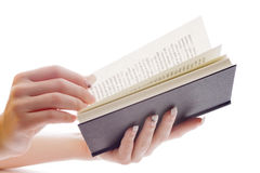 Hands turning over book pages Royalty Free Stock Photos