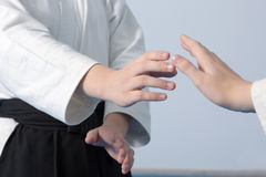 Hands of two girls standing in stance on martial arts training Royalty Free Stock Photo