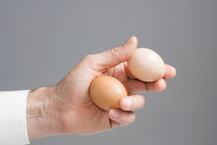Hands with two hens eggs. Stock Photo