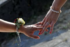 The hands of two married women with the wedding rings stock image
