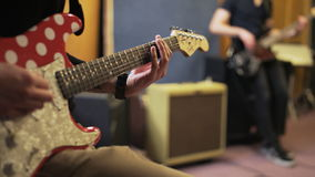 Hands of Two Men Playing Electric Guitars. Music band rehearsal. Close-up. Shot on RED Epic stock video