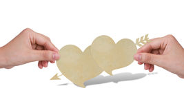 Hands with two paper heart. Stock Photos