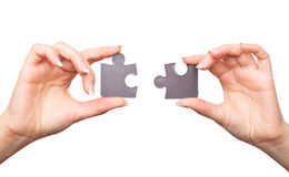 Hands with two puzzles Royalty Free Stock Photo