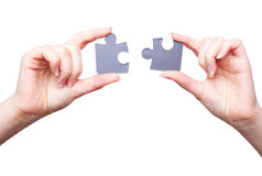 Hands with two puzzles Royalty Free Stock Images