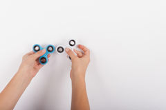 Hands with two spinning fidget spinners Stock Image