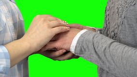 Hands of two women. Green screen. Close up. Hands of two women are in the castle and show them. Green screen. Close up stock video