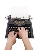Hands on a typewriter Stock Photography