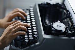 Hands on typewriter keyboard Royalty Free Stock Images