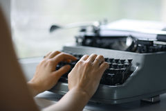 Hands on typewriter keyboard Stock Photo