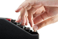 Hands on a typewriter Stock Image