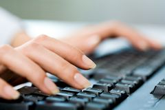 Hands typing Stock Photography