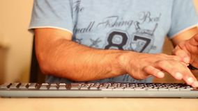 Hands typing on the computer keyboard timelapse. Close up shot of stock video footage