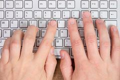 Hands typing on a computer keyboard Royalty Free Stock Image