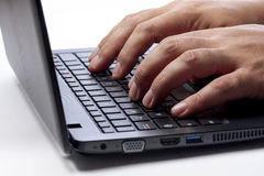 Hands Typing on Computer Laptop Side view Stock Photos