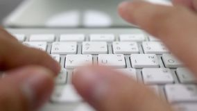 Hands typing on a keyboard. Close up stock video
