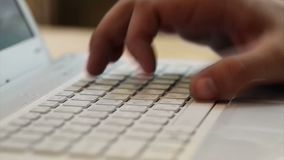 Hands typing on the keyboard. Closeup. The laptop on the table. Without sound. Open diaphragm, the Blogger writes a. Hands typing on the keyboard. Closeup. The stock video footage