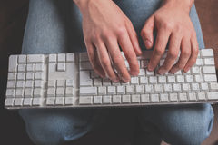 Hands typing on keyboard Stock Images