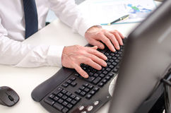 Hands typing on a keyboard Stock Photos