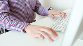 Hands typing on a keyboard stock footage